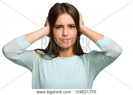 Unhappy woman closing her ears with the hands.