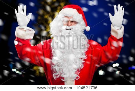 Santa Claus under the snow