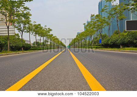 Empty Road Surface With Modern City Buildings Background