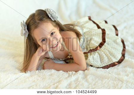 Girl with bows on the bed
