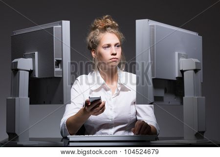 Overworked Woman Sitting At Computers