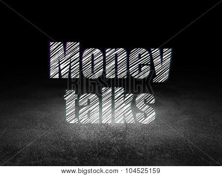 Business concept: Money Talks in grunge dark room