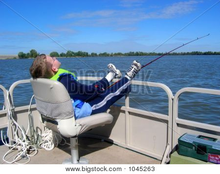 Boy Fishing From Boat