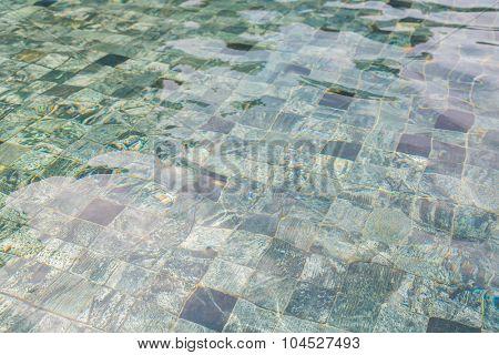 Swimming pool rippled water