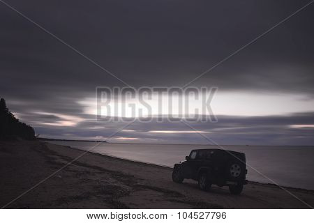 Gulf of Finland, Russia OCTOBER 05, 2015: photos of jeep Wrangler on the beach of the Gulf of Finlan