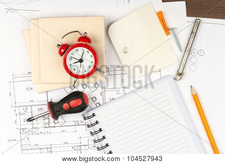 Copy book with tiles and alarm clock