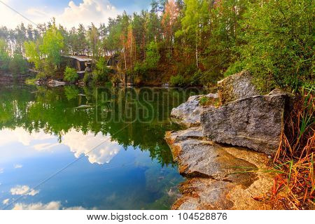 Autumn scene on lake with rocky shore