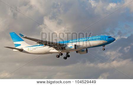 MIAMI, USA - JAN 26, 2015: Aerolineas Argentinas Airbus-330 landing at Miami International airport.