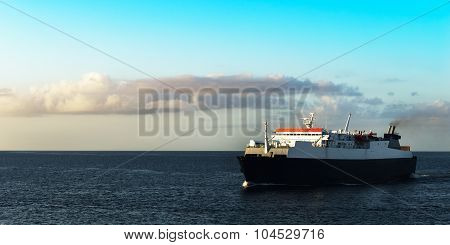 Ferry boat transporting passengers sailing sunrise in Trinidad and Tobago