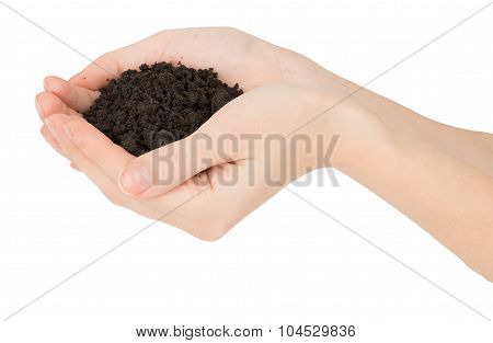 Heap of ground in hands, close up view