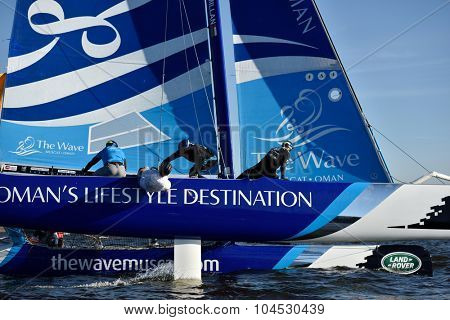 ST. PETERSBURG, RUSSIA - AUGUST 20, 2015: Catamaran of The Wave, Muscat sailing team of Oman during 1st day of St. Petersburg stage of Extreme Sailing Series. Red Bull Sailing Team won the day