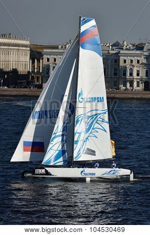 ST. PETERSBURG, RUSSIA - AUGUST 22, 2015: Catamaran of Gazprom Team Russia during 3rd day of St. Petersburg stage of Extreme Sailing Series. The Wave, Muscat team of Oman leading after 2 days