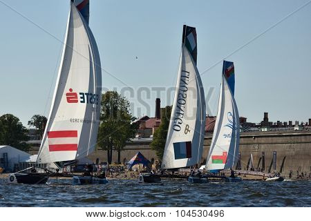 ST. PETERSBURG, RUSSIA - AUGUST 20, 2015: Extreme 40 catamarans during 1st day of St. Petersburg stage of Extreme Sailing Series. Red Bull Sailing Team of Austria won the day with 58 points