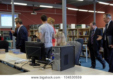 ST. PETERSBURG, RUSSIA - SEPTEMBER 3, 2015: People in the library of the new academic building of the local campus of Higher School of Economics. St. Petersburg campus of HSE was founded in 1998