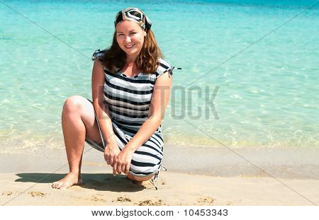 Young Pretty Girl On A Sandy Beach Near The Shore Blue Sea