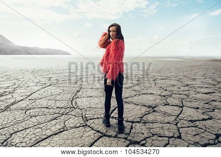Young Female Model Walking On Dry Land
