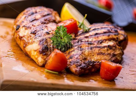 Grilled chicken breast in different variations with cherry tomatoes, green French beans, garlic