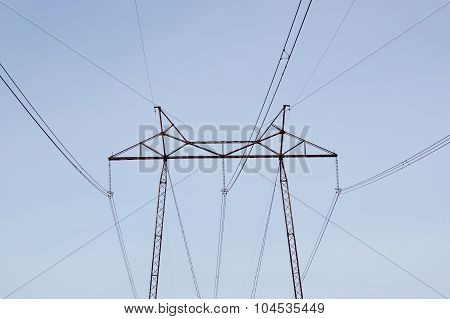 High Voltage Post. High-voltage Tower Sky Background. Power Lines.