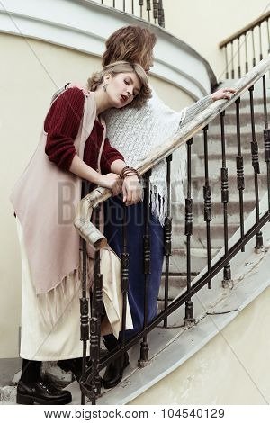 photo of a two beautiful women posing on a stairs
