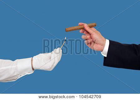Hand holding a cigar