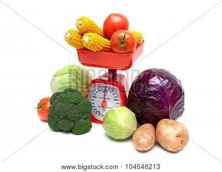 Vegetables And Kitchen Scales On A White Background
