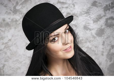 Portrait Of A Beautiful Young Woman In A Bowler Hat