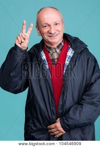 Portrait Of A Senior Man Showing Ok Sign