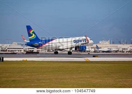 FORT LAUDERDALE, USA - April 5, 2015: A Spirit Airlines Airbus A320 landing.