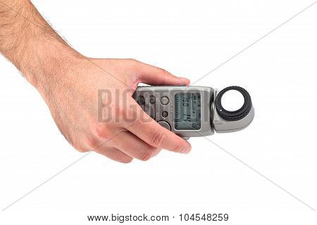Hand holding a light meter