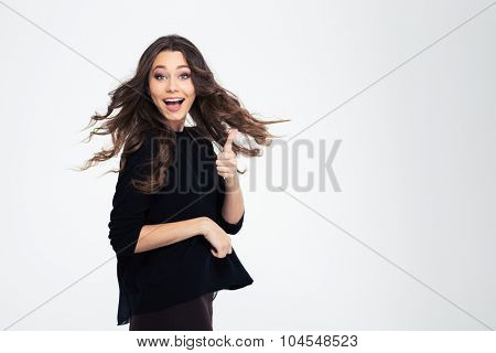 Portrait of a happy young girl showing thumb up isolated on a white background