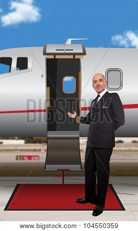 Pilot standing at the door of a private jet