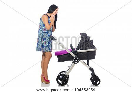 Happy mom with her baby in pram