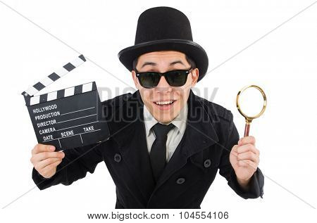 Young detective with clapboard and loupe isolated on white