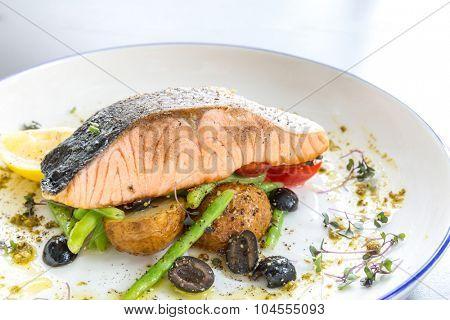 grilled salmon steak with pesto sauce