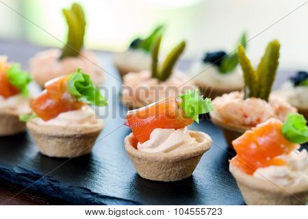 Mini Puff Pastry Tartlets With Smoked Salmon Filling.