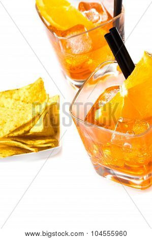 Top Of View Of Hot Tacos Chips In Front Of Two Glasses Of Spritz Aperitif Aperol Cocktail With Orang