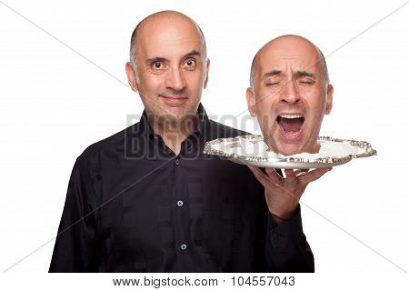 Man holding a head on a platter