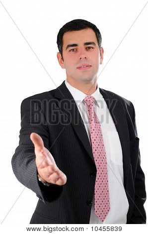 Portrait of a young businessman in a dark suit ready to handshake isolated on white