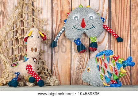 Stuffed Funny Toys On Wooden Background