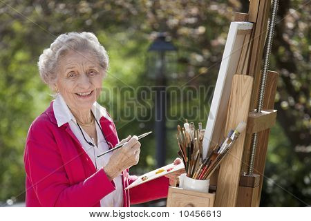 Smiling Senior Woman Painting
