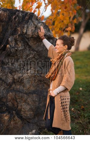 Happy Woman In Knitted Cardigan Enjoying Evening In Autumn Park