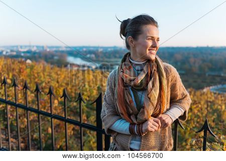 Portrait Of Relaxed Brunette Woman In Evening Autumn Park