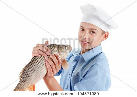 Young Chef Holding A Fish Carp On White Background