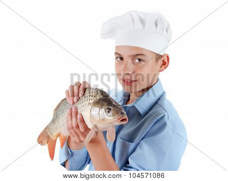 Young Boy Prepare A Fish Carp On White Background