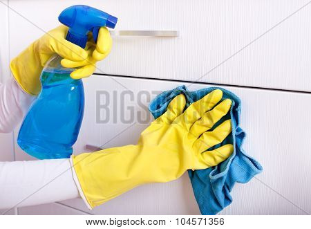 Woman Cleaning Drawers