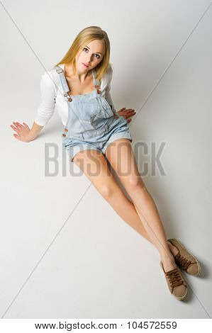 Young girl on grey background