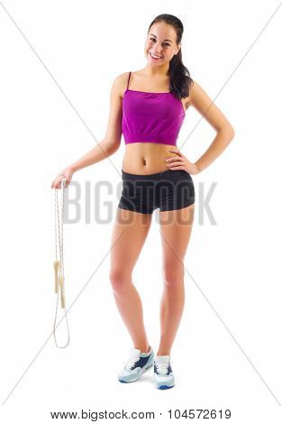 Young sporty woman with skipping rope isolated