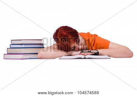Woman sleeping during preparation for exam