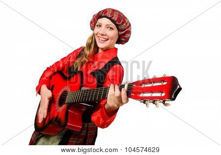 Funny woman in scottish clothing with guitar