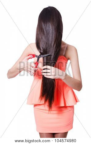 Woman cutting her hair isolated on white